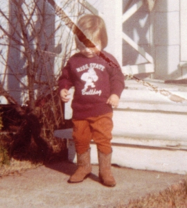 Lee Ann as a toddler. Bulldog Shirt and cowboy boots.